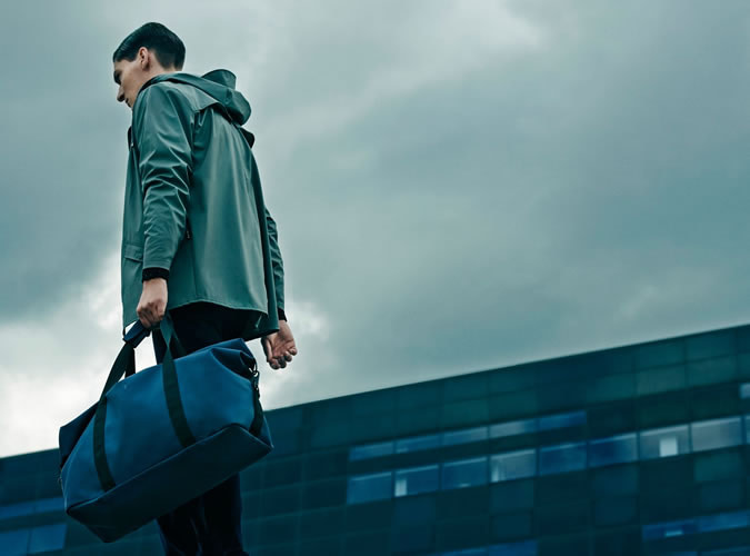 rains jacket and weekend bag
